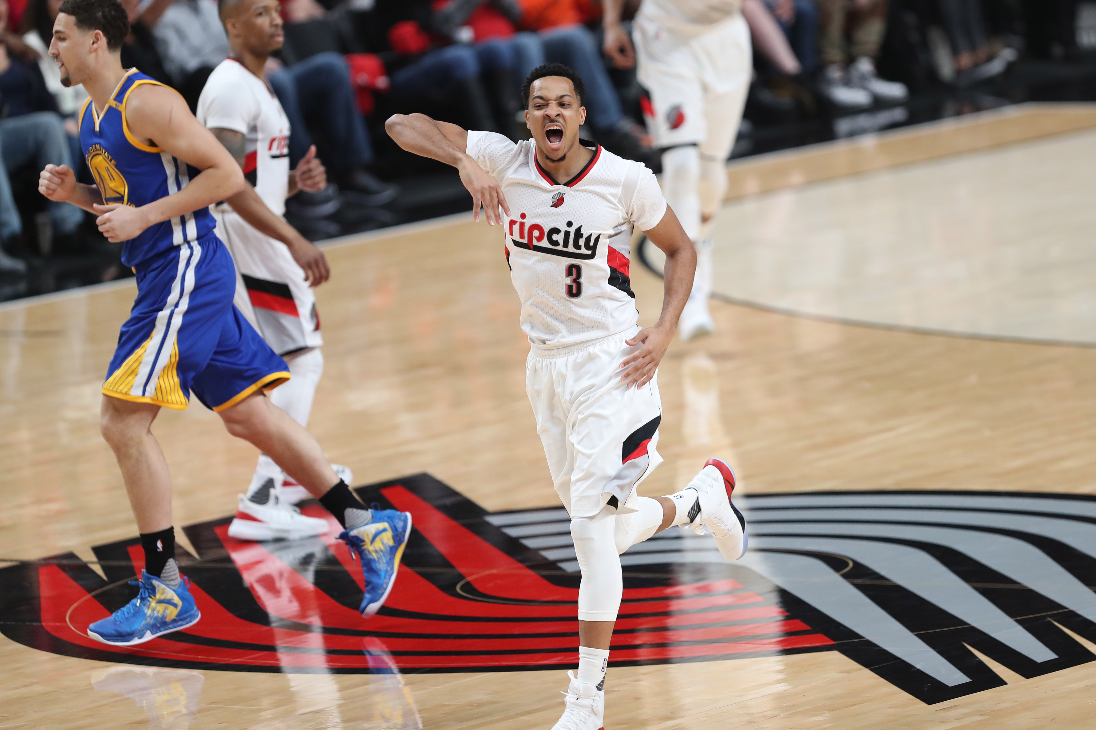 los angeles 09fce 65bf3 Apr 22, 2017  Portland, OR, USA  Portland Trail Blazers guard CJ McCollum  (3) celebrates after scoring against the Golden State Warriors in game  three of ...